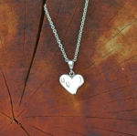 JM609SS Hoof prints on heart pendant
